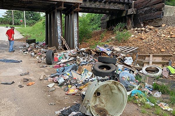 illegal dump site under railroad overpass