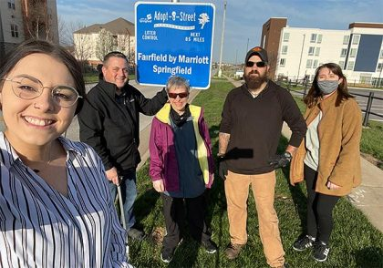 group selfie of five people who cleaned up their adopted street segment